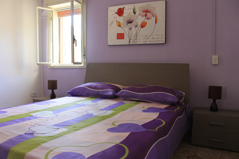 camera-da-letto-casa-portopalo
