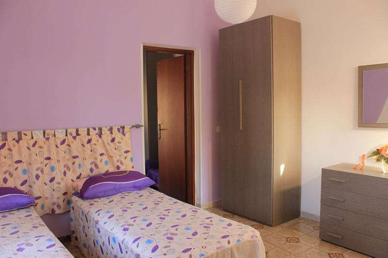 camera-letto-casa-vacanza-portopalo